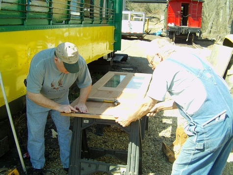 19 Jim King and Buddy Hooper work on new doors for 119.jpg