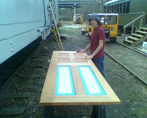 23 Jonah Iliana prep doors for painting.jpg
