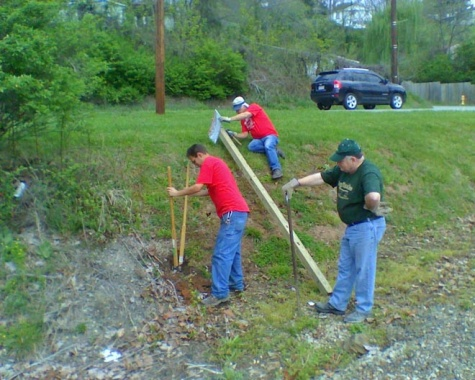 Ben, Jim, and John putting up No Trespassing Signs.