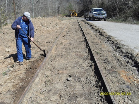 48 Brian Carns inspets track for location of new ties.jpg