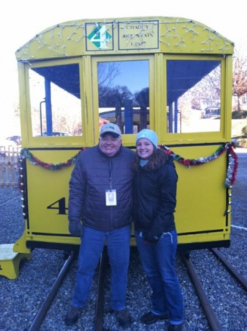 Jim King and his daughter Laura pose in front of number 4 between runs.